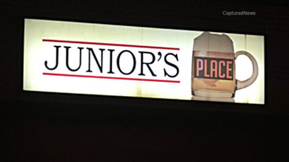 Junior's Place sign; Cook County Sheriff's Office deputies and investigators on scene at Junior's Place bar in strip mall on Grand Avenue near Wolf Road