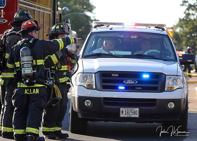 Updating fire command face-to-face at strip mall fire in Mundelein Wednesday, September 2, 2020 (PHOTO CREDIT: J. Kleeman)