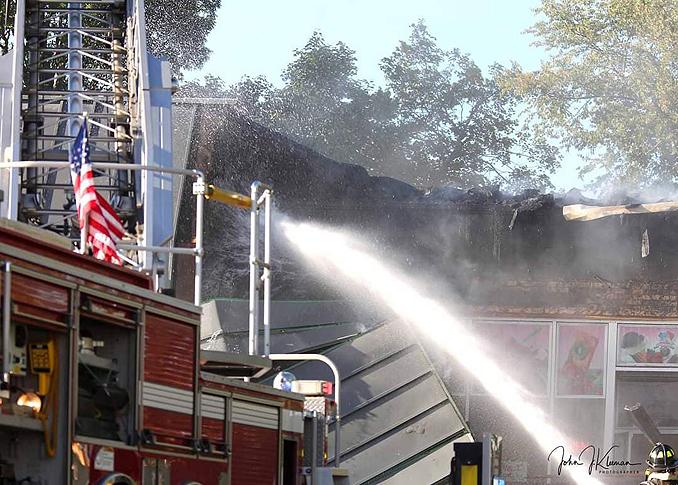 Exterior washdown at strip mall fire in Mundelein Wednesday, September 2, 2020 (PHOTO CREDIT: J. Kleeman)