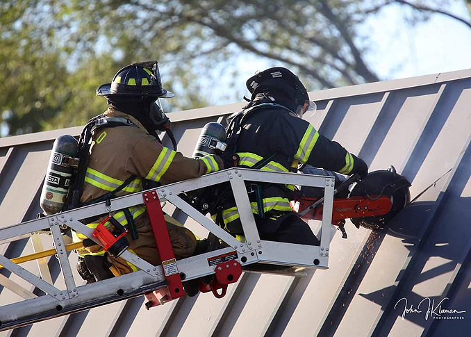 Roof operations with a K-12 circular saw at strip mall fire in Mundelein Wednesday, September 2, 2020 (PHOTO CREDIT: J. Kleeman)