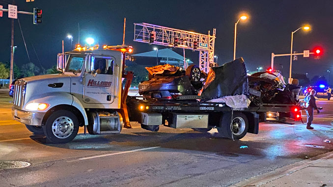 Hillside Towing removes Honda Accord in pieces after crash with utility pole at Northwest Highway and Wilke Road in Arlington Heights