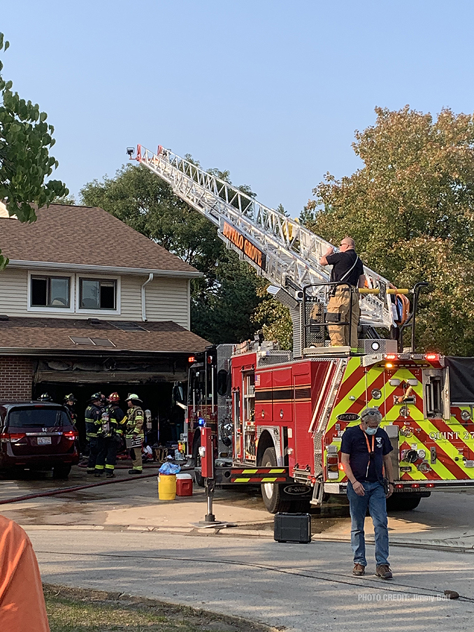 Main aerial over the roof of townhouse at attached garage fire on Pine Tree Circle North in Buffalo Grove