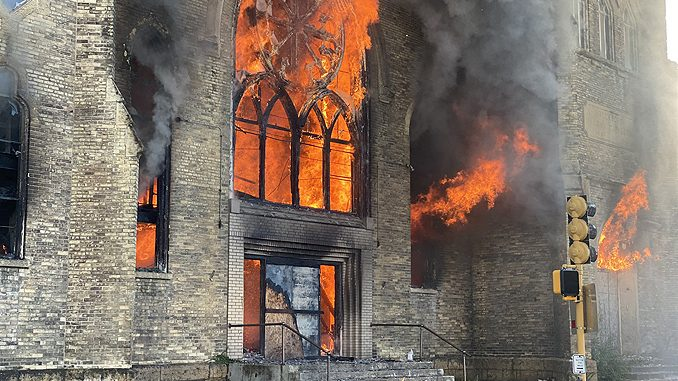 Church fire in Rockford with large flames out of windows and the front entrance on Wednesday, September 2, 2020