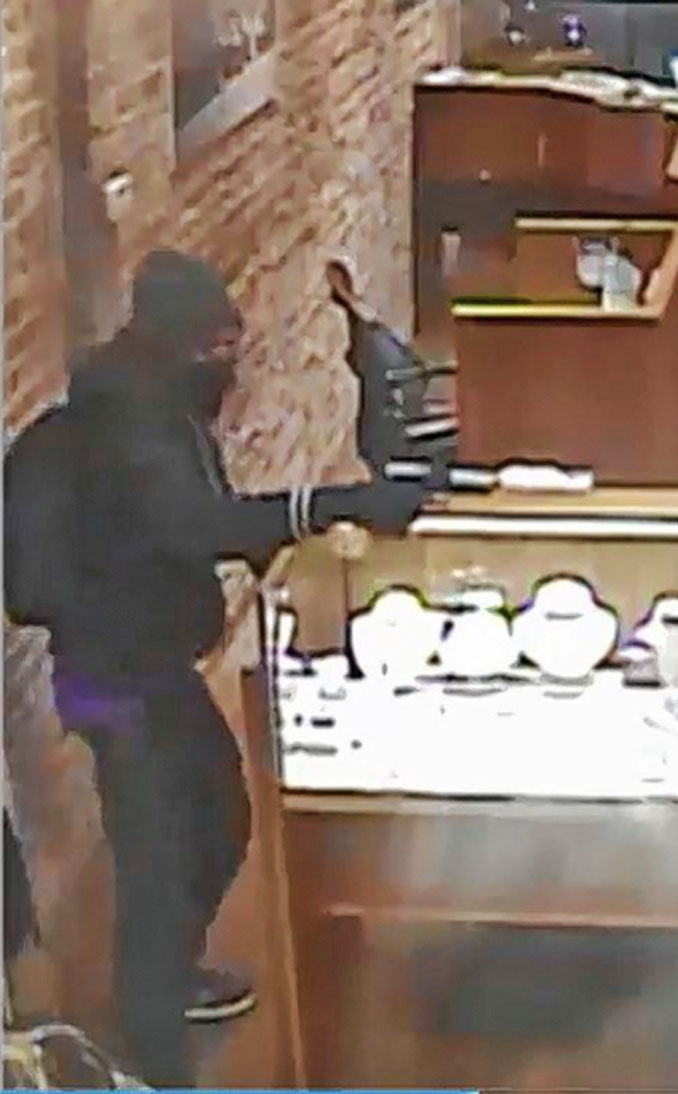 Armed offender at robber at Hinsdale Jewelry Store (SOURCE: U.S. Attorney's Office for Northern Illinois)