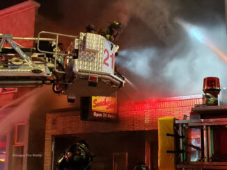 Belmont Snack Shop fire with CFD Tower Ladder 21 at the front of the building (Chicago Fire Media)