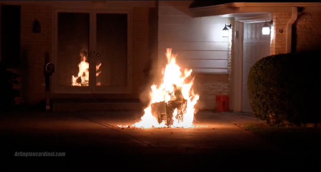 Trash can fire after passerby moved burning can away from underneath garage soffit at home on Euclid Avenue in Arlington Heights