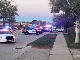White car over sidewalk at crash on Hintz Road near Mark Lane, Wheeling