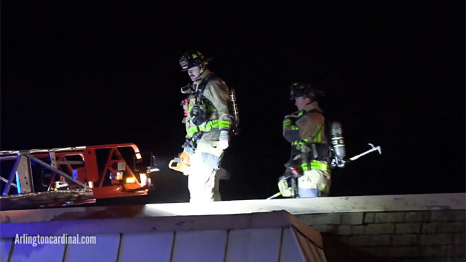 Firefighters coming off roof at condo apartment fire on Kennicott Drive in Arlington Heights on November 4, 2020