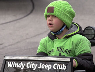 Dylan Schroeder watches for the last vehicles at the end of a fantastic Truck and Vehicle Parade on Sunday, November 29, 2020