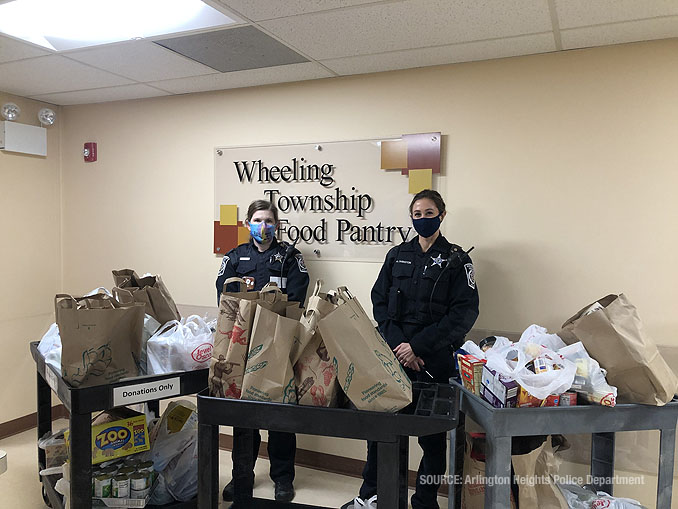 Arlington Heights police and volunteers working the 2020 Food and Toy Drive