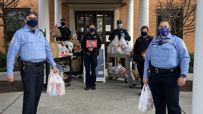 Arlington Heights police personnel with food transport at receiving at the Wheeling Township Food Pantry, 1616 North Arlington Heights for the Food and Toy Drive