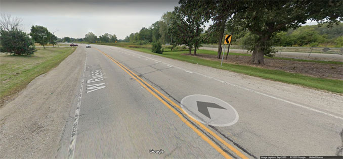 Russell Road banked curve westbound east of Delany Road near the Illinois-Wisconsin state border (Image capture September 2019 ©2020 Google)