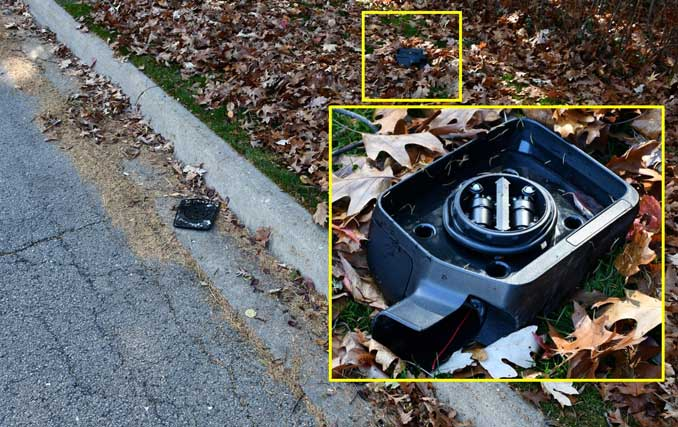 Black side mirror evidence from fatal hit-and-run pickup truck crash in Lake Forest on Mayflower Road
