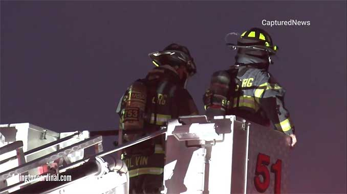 Truck 51 Schaumburg with elevated master stream at auto body shop fire on Morse Avenue in Schaumburg