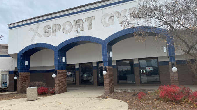 Xsport Fitness sign removed at 320 East Golf Road in Arlington Heights