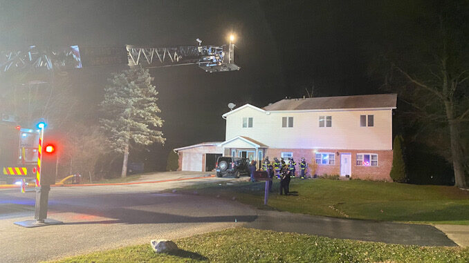 """Main aerial ladder raised """"just in case"""" at a house fire on Yale Court in Arlington Heights"""
