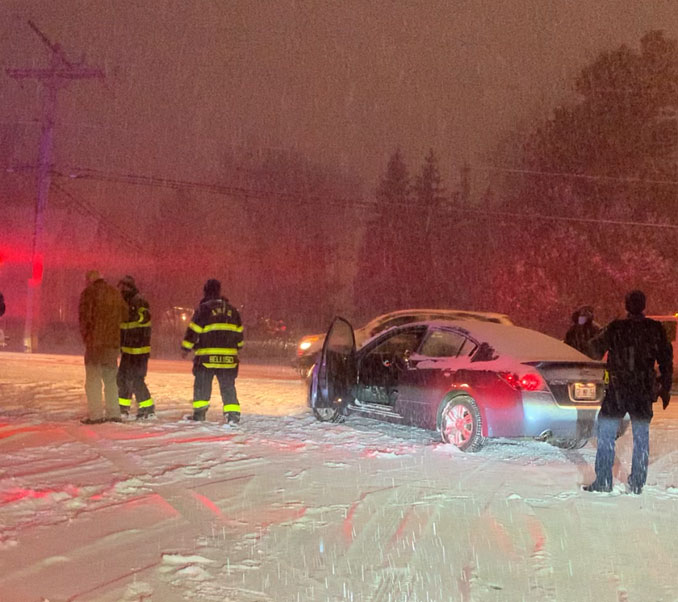 Arlington Heights Fire Department paramedics help a man who was involved in a crash with a snow plow near Hersey High School