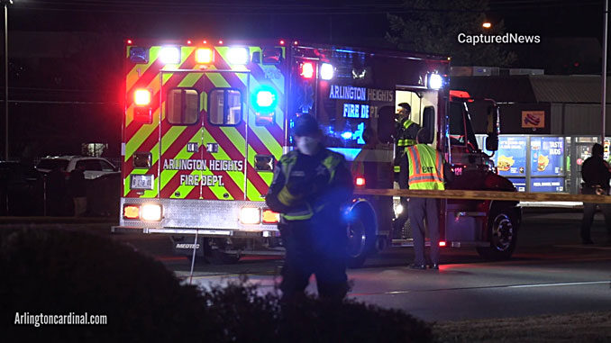 Arlington Heights Fire Department paramedics calling in to hospital while police secure a perimeter around the crash scene on Rand Road