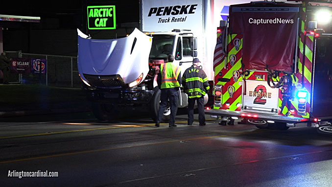 White Penske box truck at scene where pedestrian was hit and killed on Rand Road between Dryden Avenue and Thomas Street