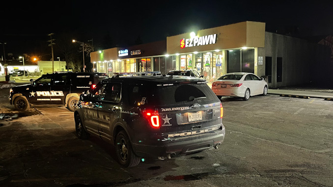 Arlington Heights Police Department begins an investigation of an armed robbery at a pawn shop, checking security cameras on Friday, January 22, 2021