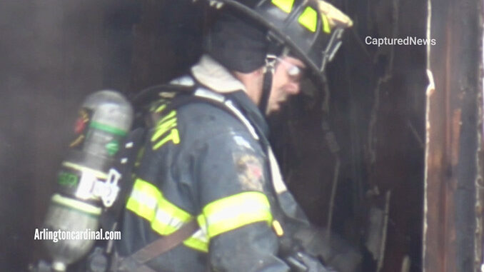 Firefighter working overhaul inside scene of a house fire that killed four girls and her mother