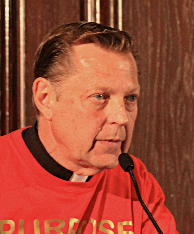 """Father Michael Pfleger at City Club of Chicago event, """"Chiraq Dr. Carl Bell, Hon. Will Burns, John Fountain, and Rev. Michael Pfleger"""" (SOURCE: Daniel X. O'Neil from USA, CC BY 2.0, via Wikimedia Commons)"""