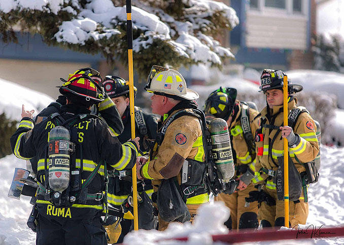 Fireground strategy at a house fire on Patton Drive in Buffalo Grove (PHOTO CREDIT: J Kleeman)