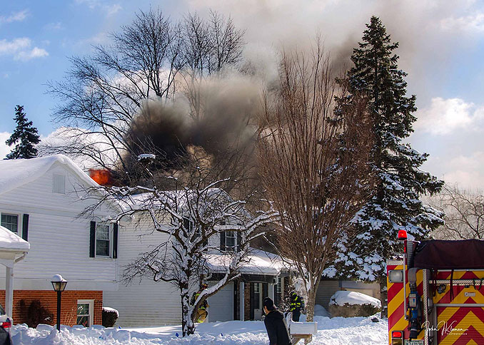 Smoke showing from the back of a house at a house fire on Patton Drive in Buffalo Grove (PHOTO CREDIT: J Kleeman)