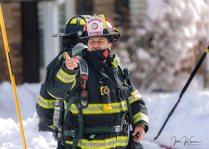 Fire lieutenant from Prospect Heights work at house fire on Patton Drive in Buffalo Grove (PHOTO CREDIT: J Kleeman)