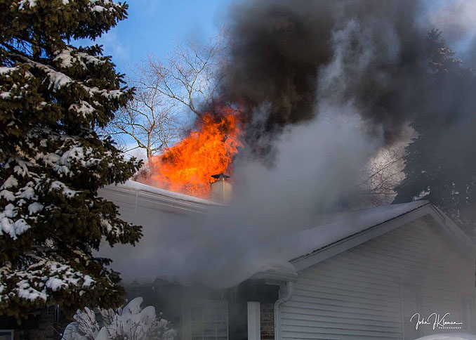 Heavy fire through the roof on Patton Drive in Buffalo Grove (PHOTO CREDIT: J Kleeman)