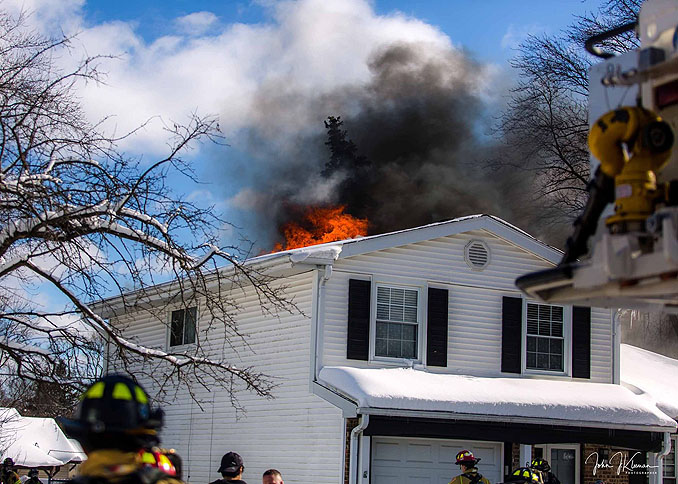 Fire and smoke showing through the roof on Patton Drive in Buffalo Grove (PHOTO CREDIT: J Kleeman)