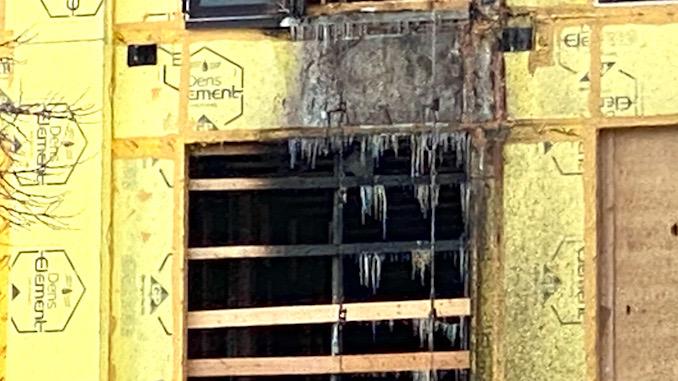 treet Lofts external construction trash chute fire
