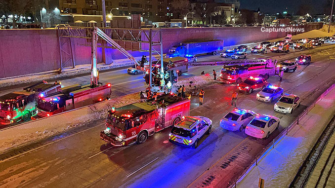 Squad 5 with snorkel up and Truck 18 with main aerial up during difficult extrication on the Dan Ryan Expressway on Tuesday, February 9, 2021 (PHOTO: Captured News)