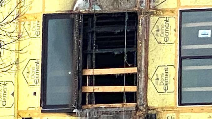 Fourth floor Maple Street Lofts external construction trash chute fire