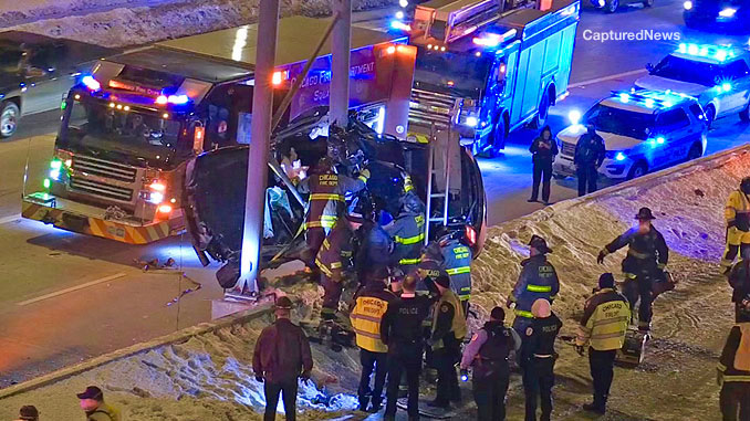 Chicago firefighters working to extricate victims from a Chrysler 300 on the Dan Ryan Expressway Tuesday, February 9, 2021 (CapturedNews)