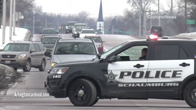 Police block Algonquin Road just west of Hammond Drive after a head-on crash in front of Escape Lounge & Bar in Schaumburg