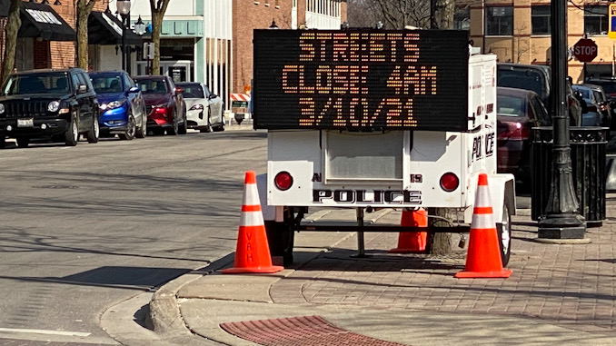 Portable electronic sign board announces Arlington Alfresco street closures at 4 AM Wednesday, March 10, 2021