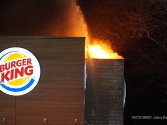 One hand line stream just after fire breaks through the roof at extra alarm fire at Burger King on Rand Road in Lake Zurich (PHOTO CREDIT: Jimmy Bolf).