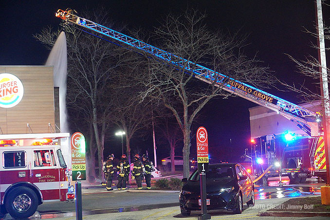 Buffalo Grove crew soaking the roof at extra alarm fire at Burger King on Rand Road in Lake Zurich (PHOTO CREDIT: Jimmy Bolf)