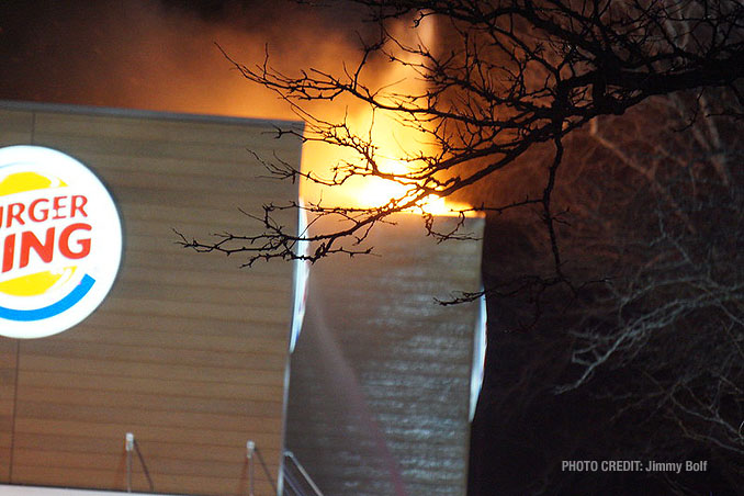 Fire breaks through the roof at extra alarm fire at Burger King on Rand Road in Lake Zurich (PHOTO CREDIT: Jimmy Bolf)