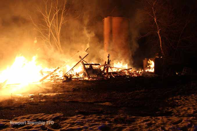 Fire burns with most of burning barn collapsed on property on Kazmer Road in Newport Township (SOURCE: Newport Township Fire Protection District)