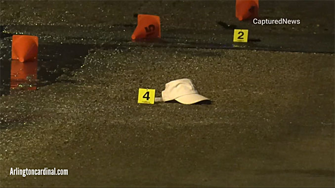 Evidence markers on Silver Lane south of Norway Lane in Palatine Township after a fatal shooting