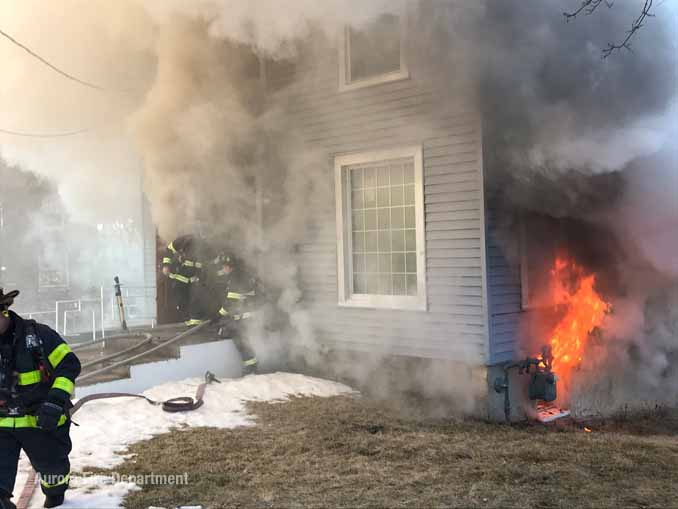 Fire venting from a basement window near a gas meter (SOURCE: Aurora Fire Department)