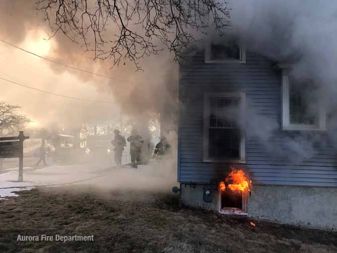 Flames venting from a basement window on Downer Place in Aurora (SOURCE: Aurora Fire Department)