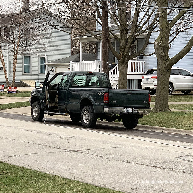 Power line down on pickup truck on Dunton Avenue between Euclid Avenue and Hawthorne Street in Arlington Heights