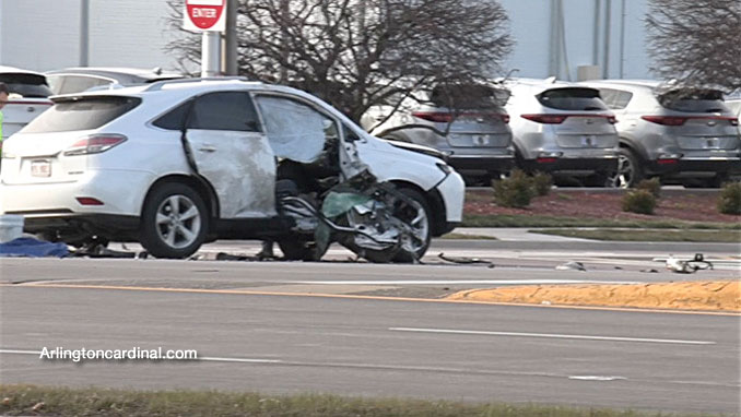 Part of the frame of the motorcycle against the passenger side of the Lexus SUV at Golf Road and National Parkway in Schaumburg