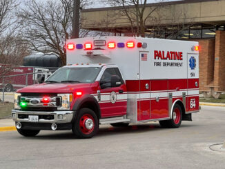 Paramedic crew from Palatine Ambulance 84 transporting a patient found on the roof at William Fremd High School to a local hospital