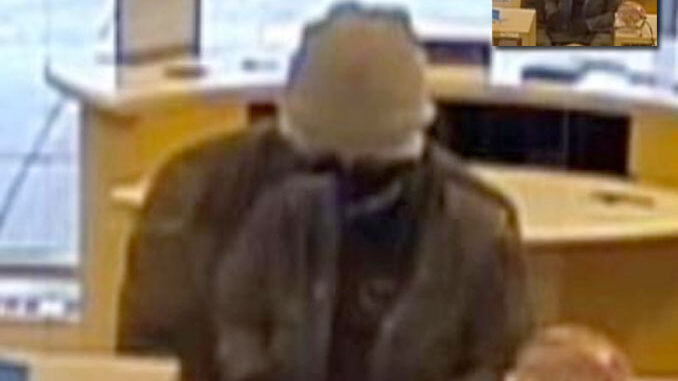 Bank robber at BMO Harris Bank, 9101 Cermak Avenue in Riverside (surveillance video still)
