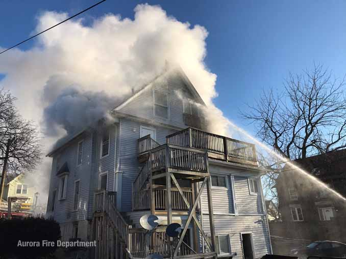 Water stream to an upper floor at the fire on Downer Place Aurora on Tuesday, March 2, 2021 (SOURCE: Aurora Fire Department)