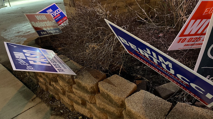 Gina Faso sign bent down at Northwest Highway and Vail Avenue, at the Mobil gas station